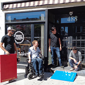CSI Member StopGap Foundation outside a storefront with a ramp