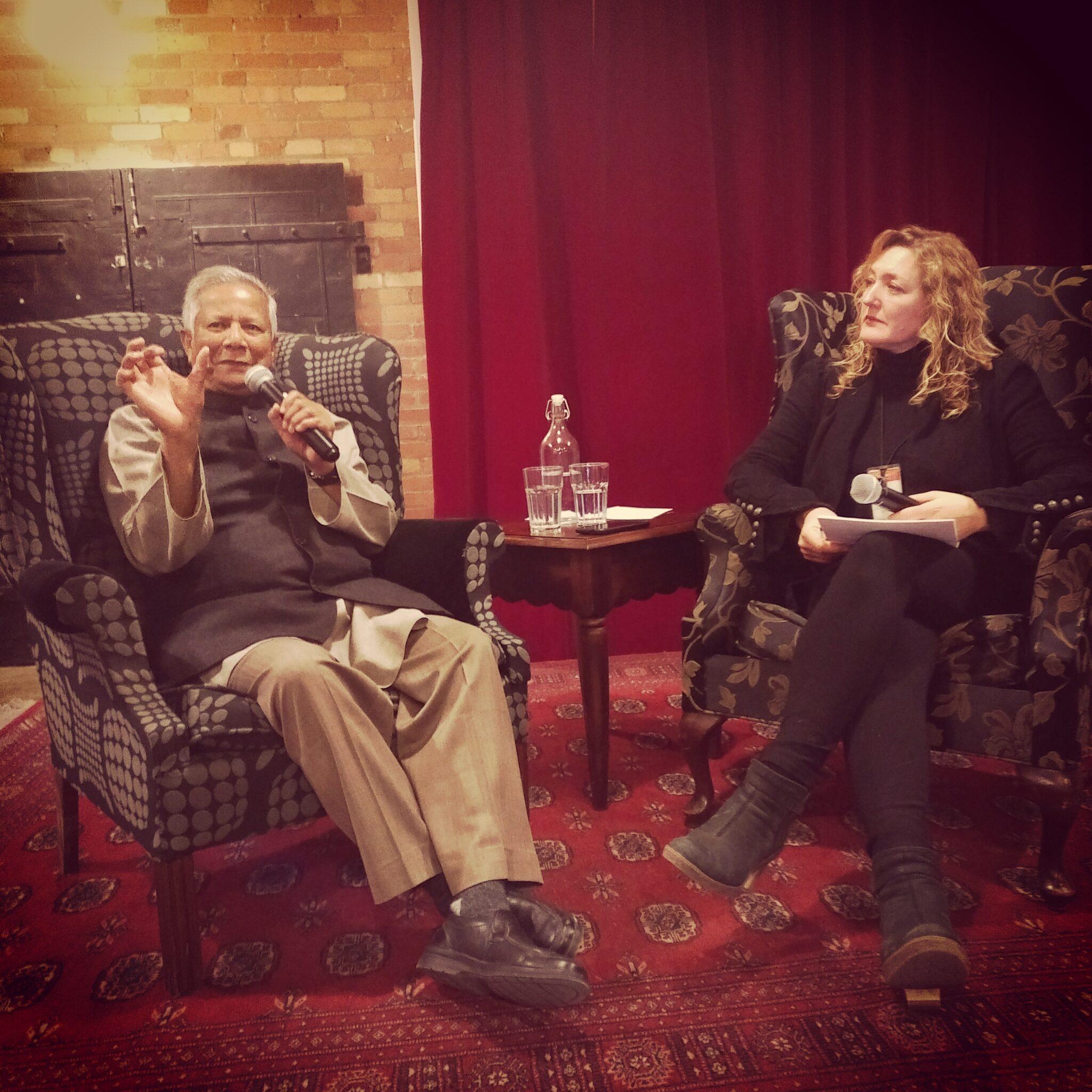 Tonya speaking to Muhammad Yunus at CSI Annex