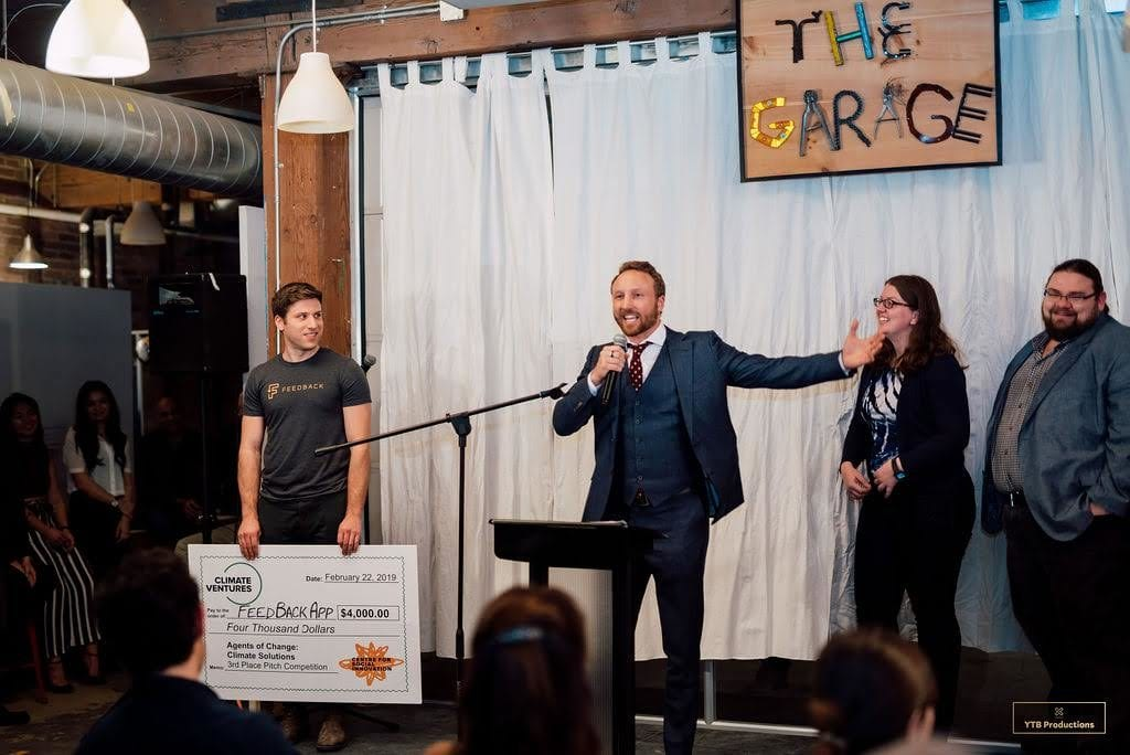 Barnabe Geis, CSI's Director of Programs, awarding a cash prize to the winner of the Agents of Change: Climate Solutions Pitch Night