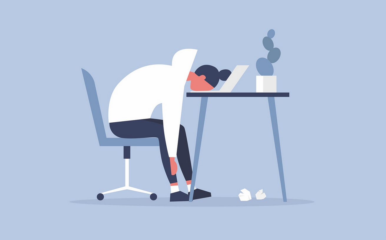 An illustration of a person slumped at their work desk with their face resting on their laptop.
