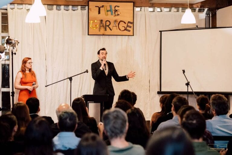 Stefan Hostetter emceeing our Agents of Change Pitch Night. Photo credit: You The Best Photography