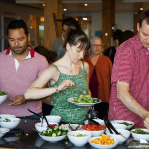 Woman serving herself at Salad Club
