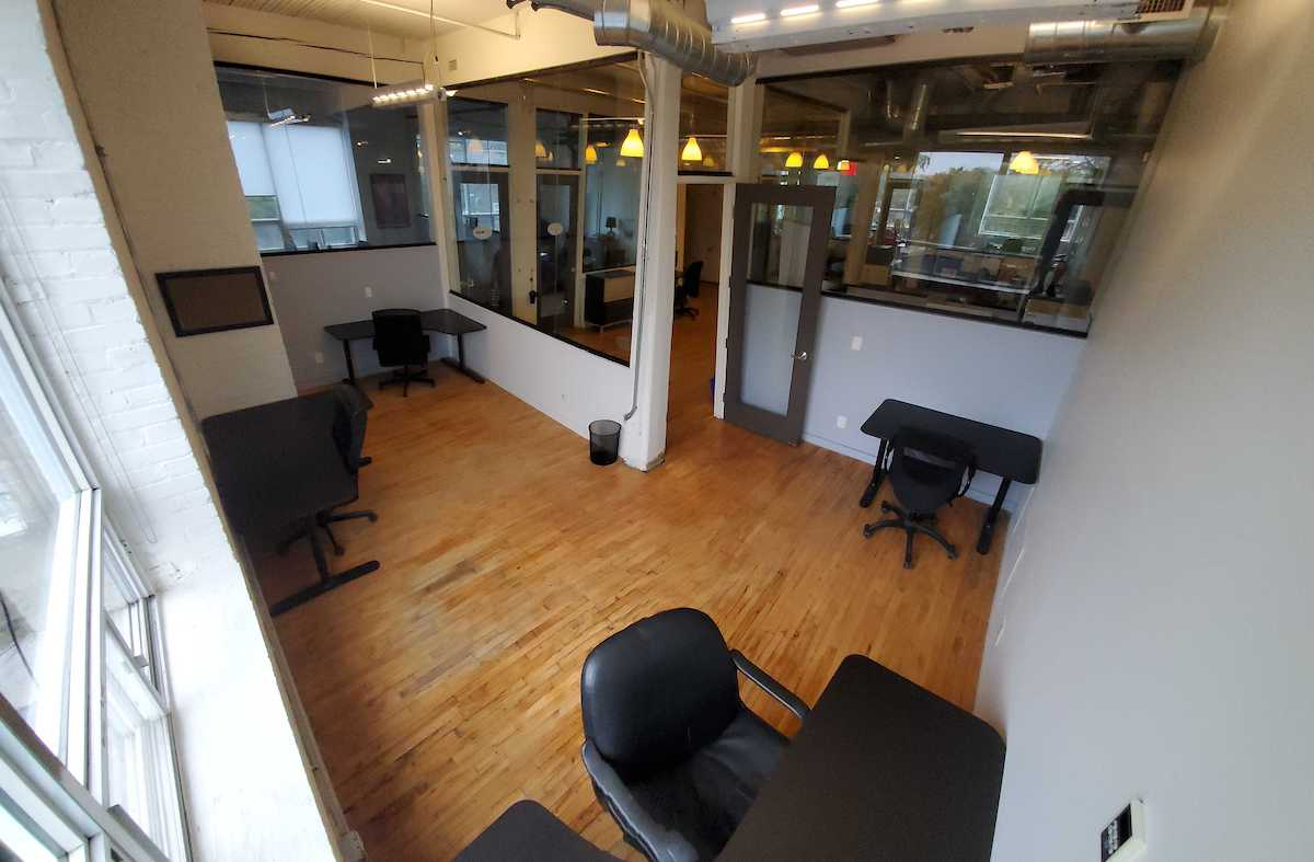 CSI Annex #309 is a bright L-shaped office perfect for a team of 3-4
