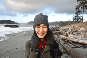 Dr. Melissa Lem smiling on a British Columbia beach