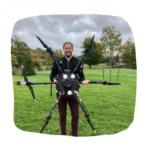 Photo of Bryce Jones holding drone