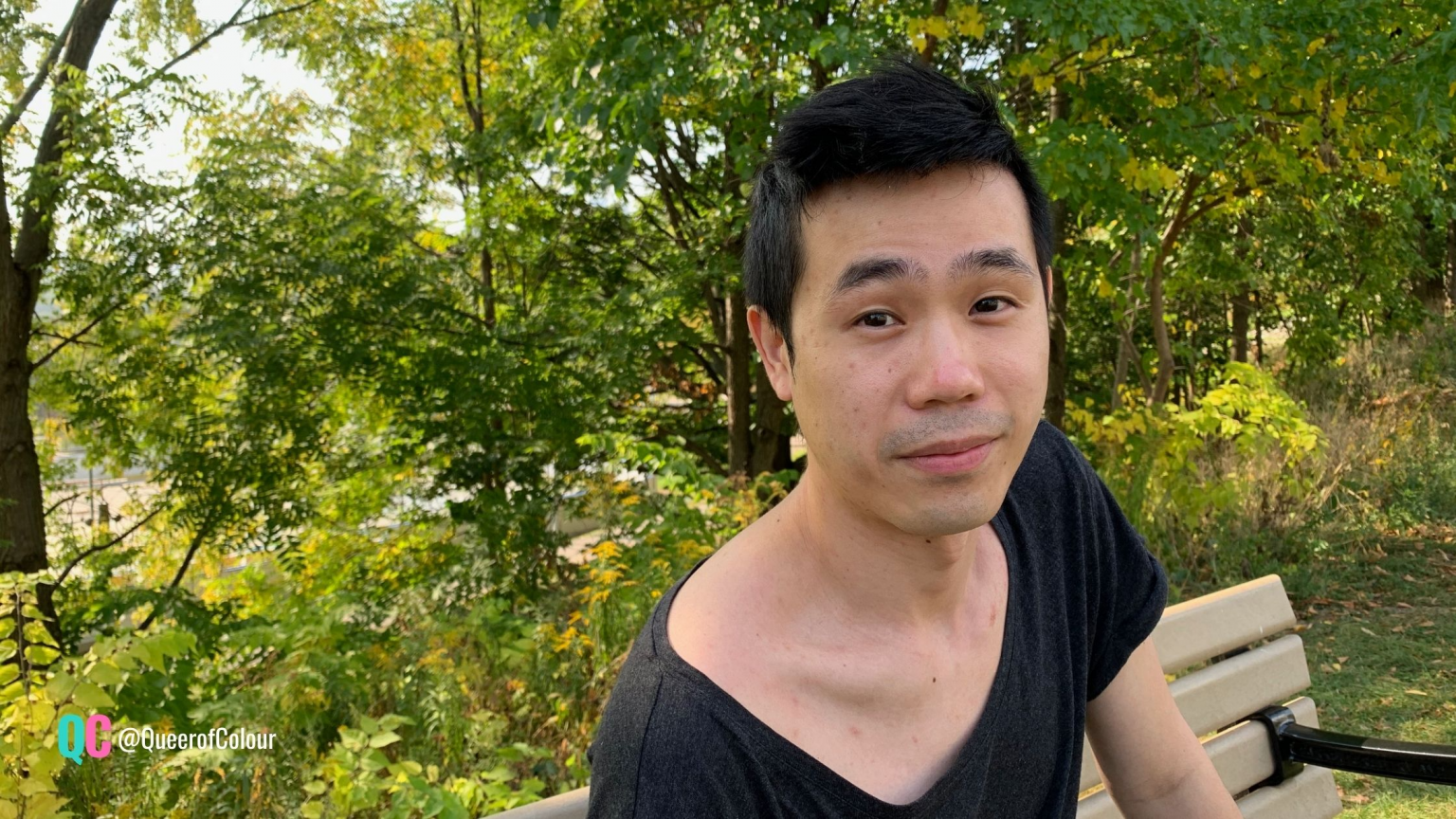 Jeff Ho sitting on a bench in a park
