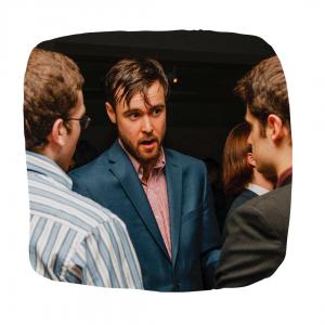 Photo of Jonas Goldman talking to two people